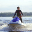 Young man on the Jetski - Stock Photo