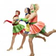 Three stylish young woman in bright colour dresses — Stock Photo