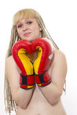 Young woman with boxing gloves over white — Stock Photo