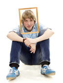 Young man posing in a frame from the picture — Stock Photo