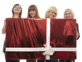 The girls with the big red box — Stock Photo