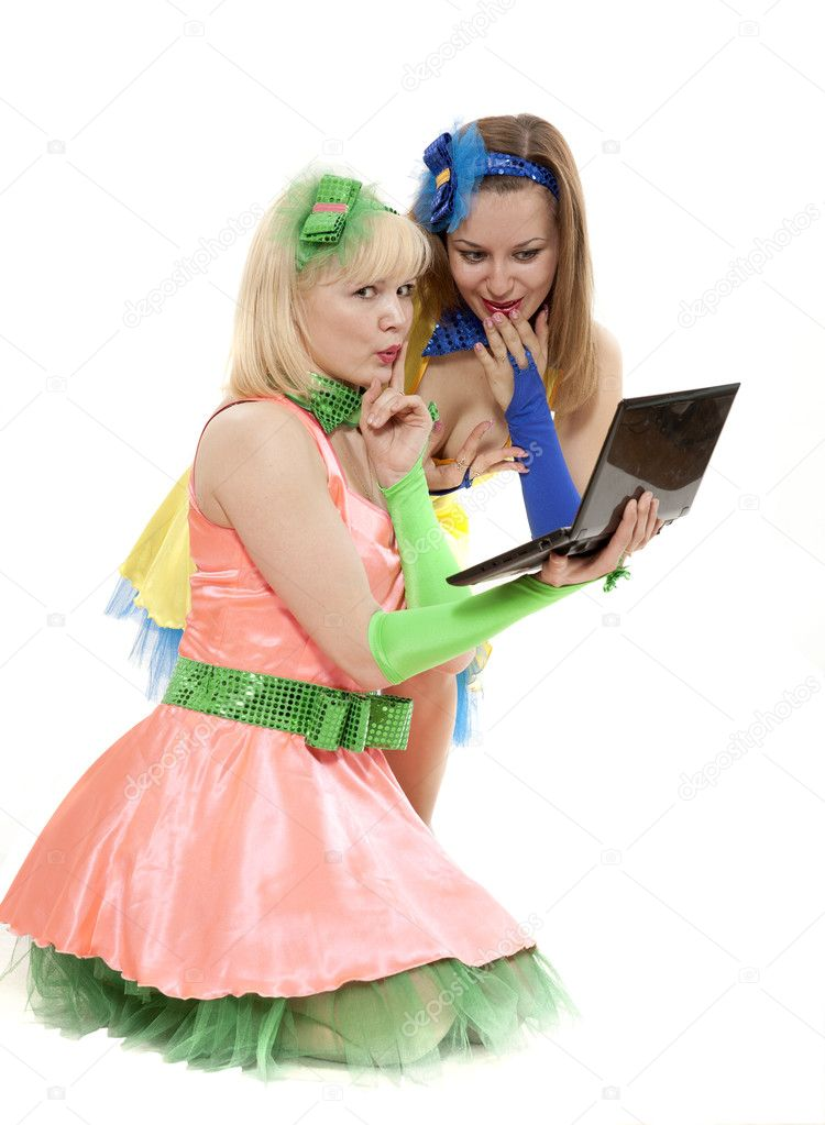 Two young beautiful women in colour dresses emotionally look the computer — Stock Photo #7417665