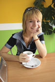 Girl holding a cup of coffee — Stock Photo