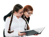 Two girls read the book — Stock Photo