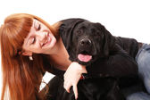 The young woman hugging a mix breed dog — Stock Photo