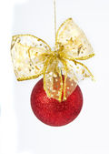 Christmas red ball with gold bow — Stock Photo