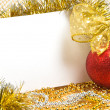 Christmas ball with tinsel and postcard — Stock Photo