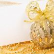 Royalty-Free Stock Photo: Christmas ball with bow and postcard