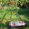 Hand lawnmower in garden — Stock Photo