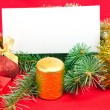 Stock Photo: Christmas decorations with card on red