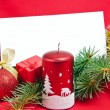 Christmas decorations with card on red — Stock fotografie