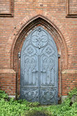 Old gothic church metal door — Stock Photo