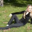 Girl sitting on grass - Stock fotografie