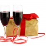 Red wine, gift and chocolates — Stock Photo