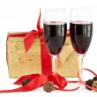 Red wine, gift and chocolates — Stock Photo