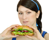 Young woman with sandwich — Stock Photo