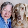 Senior woman and dog — Stock Photo