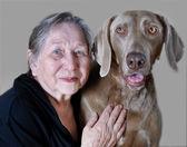 Senior woman and dog — Stock Photo