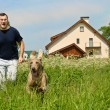 Man and dog running outdoors — Stok fotoğraf