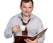 Young man drinking coffee — Stock Photo