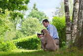 Man and dog outdoors — Stock Photo