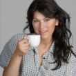 Young woman drinking coffee — Stock Photo #7198927