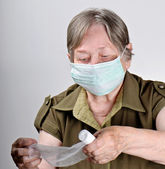 Senior woman wearing protective mask — Stock Photo