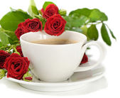Coffee and roses isolated on white — Stock Photo