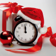 Alarm clock with gift — Stock Photo