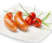 Sausage with tomatoes — Stock Photo