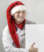 Smiling chef holding menu — Stock Photo