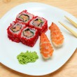 Rolls and sushi on plate — Stock Photo #6837211