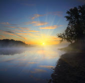Beautiful fog sunrise on river — Stock Photo