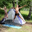 Happy boys jumping near camping tent — Stock Photo