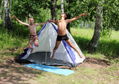 Happy boys jumping near camping tent — Stok fotoğraf