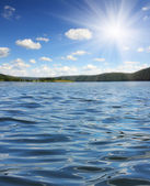 Summer lake with waves — Stock Photo