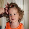 Combing hair little girl - Stock Photo