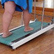 Overweight woman legs on trainer treadmill — Stock Photo #7368380