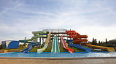 Aquapark slides and swimming-pool — Zdjęcie stockowe