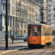 Stock Photo: Old vintage orange tram on street of Milan, Italy
