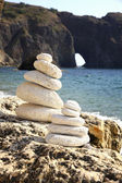 Stacks of stones on the beach — Stock Photo