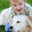 Boy with retriever outdoor — Stock Photo