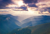 Mountains hills and sunbeams — Stock Photo