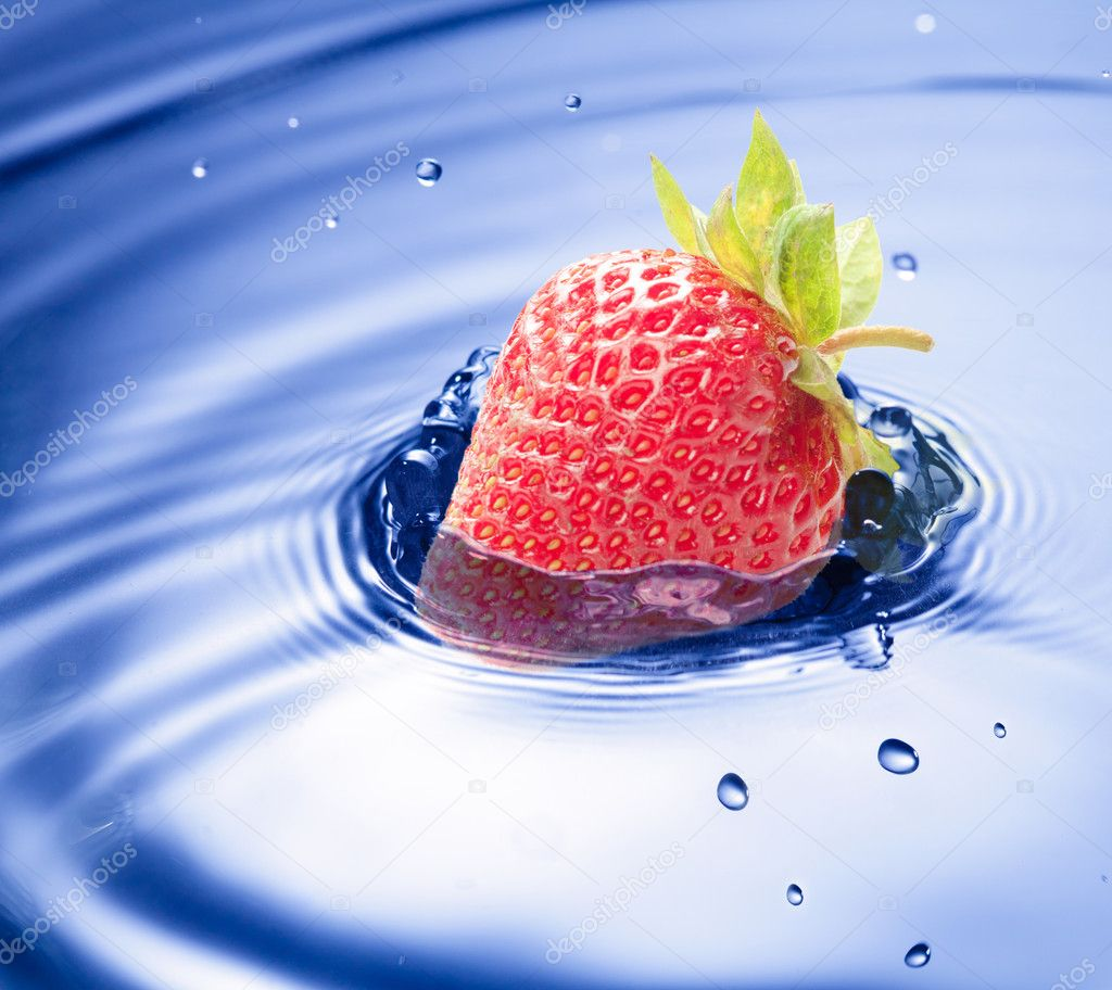 Blue water drop closeup with strawberry incide  Stock Photo #6903894