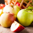 Apples on wooden table — Stockfoto