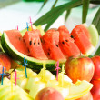 Fruits on mirror stand — Stock Photo