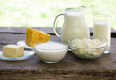 Dairy products on wooden table — Stock Photo