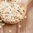 Oat flakes in spoon — Foto de stock #7134694
