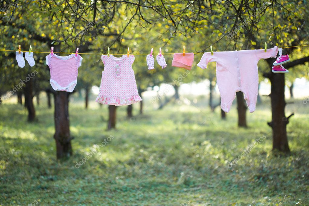 Pink baby wear outdoor in garden — Stock Photo #7185738