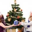 Two Christmas santa girl with gift — Stock Photo